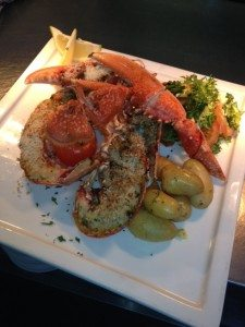 Local grilled lobster with a Citrus salad & buttered baby potatoes.